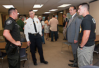 Officer Adam VanSteensburg, Chief Anthony Bean Burpee, Dan Jones and Officer Curtis Mailloux during a reception for Chief Burpee at Town Hall on Monday evening.  (Karen Bobotas/for the Laconia Daily Sun)