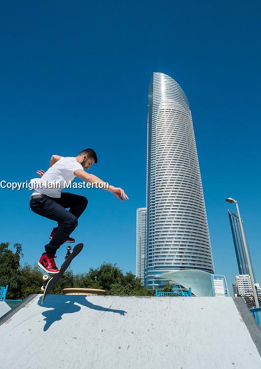 Skateboarder in skatepark on Corniche in Abu Dhabi United Arab emirates