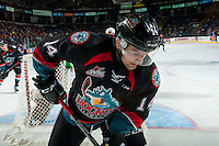 KELOWNA, CANADA - SEPTEMBER 28: Jake Kryski #14 of Kelowna Rockets digs for the puck at the boards behind the net against the Prince George Cougars on September 28, 2016 at Prospera Place in Kelowna, British Columbia, Canada.  (Photo by Marissa Baecker/Shoot the Breeze)  *** Local Caption *** Jake Kryski;