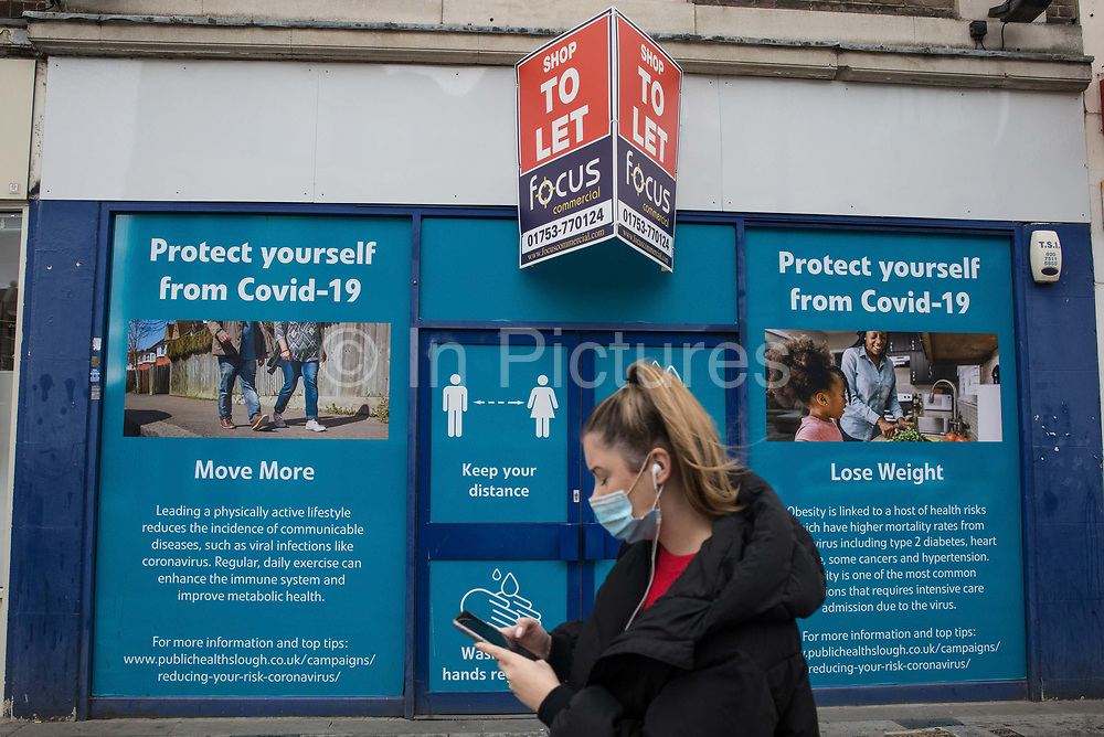 A shopper wears a face covering to help prevent the spread of the coronavirus on 23 October 2020 in Slough, United Kingdom. The Government has announced that Slough will change its COVID Alert Level status from Tier 1 Medium Alert to Tier 2 High Alert with effect from 00:01 on Saturday 24 October following a sustained rise in COVID-19 cases resulting in an infection rate of 153 cases per 100,000.