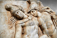 Detail of a Roman Sebasteion relief sculpture of Achilles and a dying Amazon, Aphrodisias Museum, Aphrodisias, Turkey.   <br /> <br /> Achilles supports the dying Amazon queen Penthesilea whom he has mortally wounded. Her double headed axe slips from her hands. The queen had come to fight against the Greeks in the Trojan war and Achilles fell in love with her. .<br /> <br /> If you prefer to buy from our ALAMY STOCK LIBRARY page at https://www.alamy.com/portfolio/paul-williams-funkystock/greco-roman-sculptures.html . Type -    Aphrodisias     - into LOWER SEARCH WITHIN GALLERY box - Refine search by adding a subject, place, background colour, museum etc.<br /> <br /> Visit our ROMAN WORLD PHOTO COLLECTIONS for more photos to download or buy as wall art prints https://funkystock.photoshelter.com/gallery-collection/The-Romans-Art-Artefacts-Antiquities-Historic-Sites-Pictures-Images/C0000r2uLJJo9_s0
