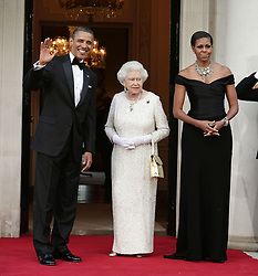 File photo dated 25/05/11 the then US President Barack Obama and First Lady Michelle Obama as they welcome the arrival of Queen Elizabeth II and the Duke of Edinburgh (not in picture) at Winfield House - the residence of the Ambassador of the United States of America - in Regent's Park, London, as part of the his state visit to the UK. Donald Trump???s state visit to the UK is only the third by a US president.