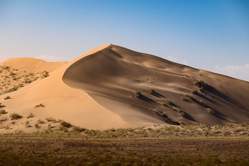 """One of many Nature's Wonders - a singing sand dune in the south of Kazakhstan. <br /> Singing sand dunes produce a sound described as roaring, booming, squeaking, or the """"Song of Dunes"""". This is a natural sound phenomenon of up to 105 decibels, lasting as long as several minutes. It occurs in 35 desert locations around the world."""