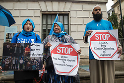 Members of the Uyghur community join activists from Uyghur Solidarity Campaign UK and other supporting groups protesting opposite the Chinese embassy in support of the Uyghur people's struggle for freedom on 5th August 2021 in London, United Kingdom. Activists highlighted the Chinese government's persecution and forced assimilation of Uyghurs, Kazakhs and other indigenous people in East Turkestan and Xinjiang and called for them to have the right to determine their own futures through a democratic process.