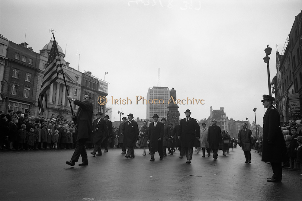 17/03/1965<br /> 03/17/1965<br /> 17 March 1965<br /> NAIDA St. Patrick's Day Parade, Dublin. nAmericans March in the Parade. This was the second year in whichh these Americans celebrated St. Patrick's Day in Dublin and New Jersey. Front rank (l-r): Eugene Farrell, Jersey City Ambassador to Ireland; Hugh J. Driscoll, Grand Marshall; james McCloskey, Past Grand Marshall and Mayor Thomas J. Whelan of Jersey City. Flag Bearer is Eugene Scanlon, General Chairman, St. Patrick's Day Parade Committee, Jersey City.