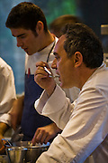 Ferran Adrià, chef of El Bulli restaurant near Rosas on the Costa Brava in Northern Spain tastes food in the kitchen while staff prepare meals. (Ferran Adrià is featured in the book What I Eat: Around the World in 80 Diets.)