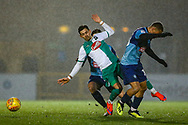 Plymouth Argyle midfielder Ruben Lameiras (11) is tackled by Wycombe Wanderers midfielder Curtis Thompson(18) during the EFL Sky Bet League 1 match between Wycombe Wanderers and Plymouth Argyle at Adams Park, High Wycombe, England on 26 January 2019.