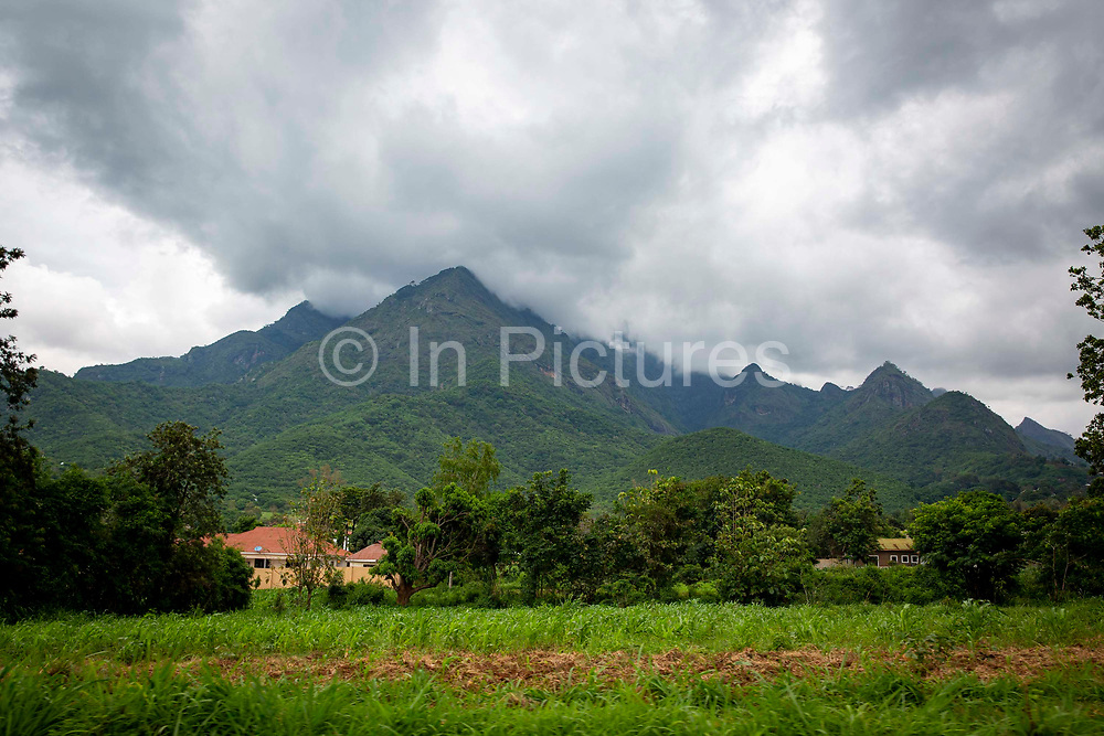 A small settlement with the Uluguru Mountains in the background on the outskirts of Morogoro the capital of the Morogoro Region on the 20th November 2019 in Morogoro, Tanzania.