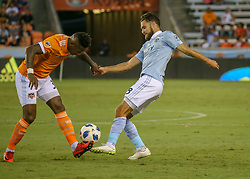 August 4, 2018 - Houston, TX, U.S. - HOUSTON, TX - AUGUST 04:  Houston Dynamo forward Romell Quioto (31) and Sporting Kansas City midfielder Graham Zusi (8) fight for ball during the soccer match between Sporting Kansas City and Houston Dynamo on August 4, 2018 at BBVA Compass Stadium in Houston, Texas.  (Photo by Leslie Plaza Johnson/Icon Sportswire) (Credit Image: © Leslie Plaza Johnson/Icon SMI via ZUMA Press)