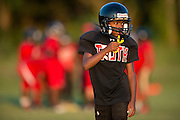 Kids from Deion Sanders youth sports organization, Truth, run through drills at the Prime Prep Academy campus in Dallas, Texas on August 6, 2014. (Cooper Neill for The New York Times)