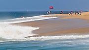 People Walking Along The Beach In Newport