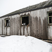 A wooden ruin of a building that forms part of the abandoned whaling station at Whalers Bay on Deceloption Island. Deception Island, in the South Shetland Islands, is a caldera of a volcano and is comprised of volcanic rock.