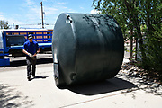 So, how do you move a 1,500 gallon cistern uphill? Same way you move any large round object. You give it a push and let it roll. When it stops rolling, you give it another push.
