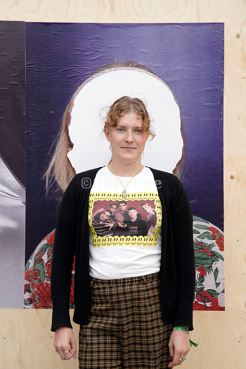 Portrait of artist Christel Thomson standing in front of her work at Unseen Amsterdam as part of the '6 Academies' project , September 2018