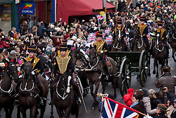 © Licensed to London News Pictures. 06/02/2012. LONDON, UK. Soldiers of the Kings Troop Royal Horse Artillery are surrounded by well wishers as they parade on St John's Wood High Street after leaving their barracks in the town for the last time. Gunners of the Kings Troop, based at St John's Wood since 1947, today (06/02/12) left their barracks for the last time to fire their guns in Hyde Park, the soldiers will move tomorrow to their new home in Woolwich. Photo credit: Matt Cetti-Roberts/LNP