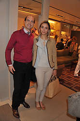 KERRY & CAROLINA MENTASTI GRANELLI at a champagne breakfast hosted by Carolina Gonzalez-Bunster and TOD's in aid of the Walkabout Foundation held at TOD's, 2-5 Old Bond Street, London on 9th May 2013.