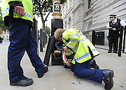 under license to London News Pictures. LONDON, UK  17/05/2011. Police officers check a lamp post outside Downing Street before placing a security seal on it. Police carry out security checks in Whitehall, Central London today (17 May 2011). Please see special instructions for usage rates. Photo credit should read Stephen Simpson/LNP.
