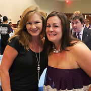 Priscilla Pope, left, and Brandy Meekins pose for a photo Saturday September 20, 2014 during the 4th Annual Care Project Gala at Union Station in Wilmington, N.C. (Jason A. Frizzelle)