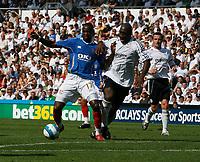 Photo: Steve Bond. <br />Derby County v Portsmouth. Barclays Premiership. 11/08/2007. John Utaka (L) tussles with Darren Moore (R)