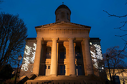 """© Licensed to London News Pictures; 01/12/2020; Bristol, UK. """"Jingle Bell, Jingle Bell, Jingle ROCK"""" is projected onto St Georges, Bristol, a music venue which is temporarily closed during the Covid-19 coronavirus pandemic lockdown in England. St Georges, Bristol is the first building to be revealed in light in a series for """"Bristol ADVENTures"""", a new arts project spearheaded by Bristol City Centre BID. This will see a new building lit each day with a selection of the most jolly and iconic Christmas lyrics, with a trail of 24 locations complete by Christmas Eve. Photo credit: Simon Chapman/LNP."""