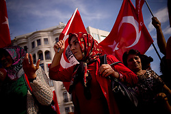 © London News Pictures. 06/06/2013 . Istanbul, Turkey. Women waving the Turkish flag in Taksim Square.  After several days of hard altercations Taksim Square in Istanbul has lived a quiet day with camping and claims against the government. Photo credit: Jordi Boixareu/LNP