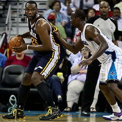 April 11, 2011; New Orleans, LA, USA; Utah Jazz center Al Jefferson (25) is guarded by New Orleans Hornets center Emeka Okafor (50) during a game at the New Orleans Arena. The Jazz defeated the Hornets 90-78.  Mandatory Credit: Derick E. Hingle