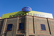 "A large banner proclaiming Bollocks To Brexit above the south London headquarters of Pimlico Plumbers, on 10th March 2019, in London, England. The controversial boss of Pimlico Plumbers is refusing to take down a giant ""bollocks to Brexit"" sign on the roof of his HQ, despite the local council ordering him to remove it or face prosecution. Bos Charlie Mullins is refusing to take down the giant sign on the roof of his company HQ, despite the local council ordering him to remove it or face prosecution. Mullins cites freedom of speech and a court case involving punk band the Sex Pistols to oppose Lambeth Council's contention that the 100ft-long sign, visible to train passengers arriving at Waterloo Station, contravenes planning law."