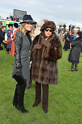 Left to right, AMANDA HOLDEN and JOAN COLLINS at the 2013 Hennessy Gold Cup at Newbury Racecourse, Berkshire on 30th November 2013.