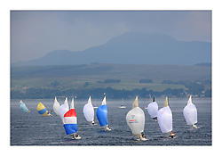 Sailing -Day 3 racing at the 8 metre World Championship 2007 held on the Clyde at The Royal Northern & Clyde YC as part of it's Centennial year..Aerial of Fleet with Ben Lomond. FIN 8 Windy and K2 Carron at the front on the pack..