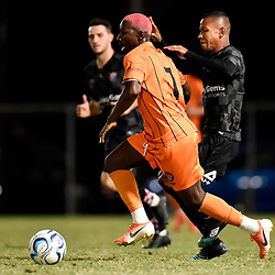 BRISBANE, AUSTRALIA - NOVEMBER 3: Abraham Yango of Eastern Suburbs and Jheison Macuace of the Knights compete for the ball during the NPL Queensland Senior Mens Round 9 match between Eastern Suburbs FC and Gold Coast Knights at Heath Park on November 3, 2020 in Brisbane, Australia. (Photo by Patrick Kearney)