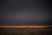 Image of the landscape during sunset and storm in Rough Rock, Arizona, American Southwest by Randy Wells