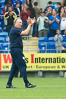 Football - 2017 / 2018 Championship - Cardiff City vs. Aston Villa<br /> <br /> <br /> Cardiff City manager Neil Warnock  applauds the fans on the pitch  after his team win 3-0, at Cardiff City Stadium<br /> <br /> COLORSPORT/WINSTON BYNORTH