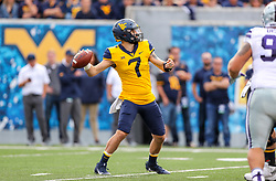Sep 22, 2018; Morgantown, WV, USA; West Virginia Mountaineers quarterback Will Grier (7) throws a pass during the first quarter against the Kansas State Wildcats at Mountaineer Field at Milan Puskar Stadium. Mandatory Credit: Ben Queen-USA TODAY Sports
