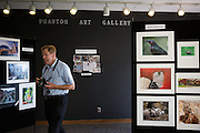 Mike Aronson, member of the Milpitas Camera Club, walks through the Milpitas Community Center's Phantom Art Gallery during the opening night of the Milpitas Camera Club's 10th Anniversary Print Show on July 23, 2012.  Photo by Stan Olszewski/SOSKIphoto.com.