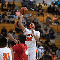 Gallup's Joaquin Ortega (30) takes a shot in the paint against Grants Tuesday night at Gallup High School in Gallup.