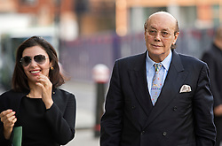 © London News Pictures. 14/08/2012. London, UK. Cypriot businessman Asil Nadir arriving at Central Criminal Court, Old Bailey, in London with his wife Nur Nadir (left) on August 14, 2012 where the jury is currently considering a verdict  in the Polly Peck fraud case. Nadir, who fled to Cyprus in 1993 after the charges were first brought, is accused of £34m fraud at his firm Polly Peck. Photo credit : Ben Cawthra/LNP