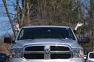 Parishioners raise their hands as they sit in their cars during Bethany Wesleyan Church's Sunday worship service Mar. 22, 2020, at Becky's Drive-In in Walnutport, Pennsylvania. Concerns over the coronavirus have closed churches in an effort to avoid gatherings of large crowds.