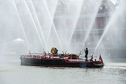 © Licensed to London News Pictures. 18/07/2015. Bristol, UK.  Bristol Harbour Festival 2015 for Bristol's year as European Green Capital.  Attractions included the Pyronaut fire fighting boat, the Young Shipwrights and Cardboard Boat Race (won by the Brunel Suspension Bridge boat) and Big Crazy Flyboarding on water jets.  Photo credit : Simon Chapman/LNP
