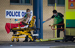 © Licensed to London News Pictures.11/01/2021, London, UK. A patient is stretchered from an ambulance at Queen's Hospital in Romford, east London as the number of coronavirus cases surge. London Mayor Sadiq Khan has declared a major incident in London as the capital's hospitals struggle to cope with the number of patients. Photo credit: Marcin Nowak/LNP