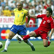 Brazil's Ronaldo battles against Turkey's Tugay KERIMOGLU.<br /> Photo by Aykut AKICI/TurkSporFoto