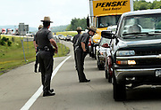 New York State Troopers inspect cars exiting off of Route 86 near Friendship, NY, Sunday, June 21, 2015. A search for two escaped convicts continued Sunday after a credible lead reported seeing them in the area. <br /> (Heather Ainsworth for The New York Times)