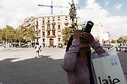 A woman takes a photograph of the Triumphal Arch in Barcelona.<br /> Spain's worst political crisis in a generation will come to a head as Catalonia's leader could declare independence from Madrid in a move likely to send shockwaves through Europe.  10, 2017 in Barcelona, Spain. Christian Mantuano / OneShot