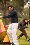 Oscar Higares, bullfighter, practices in a Madrid park (with Faith D'Aluisio as the bull) before his food photo portrait in Miraflores, Spain bullring. What I Eat: Around the World in 80 Diets. Model Released.