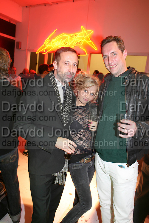 DAVE DORRELL; SCARLETT CARLOS CLARKE, Opening of Plus Art, a group exhibition produced by  Kerry Ryan and artist Declan McMullan. Britannia House,  Hanbury Street, off Brick Lane. E1 5JL. was open for 24 hours a day during the  Frieze Art Fair period..- 15 October 2010. <br /> all best,-DO NOT ARCHIVE-© Copyright Photograph by Dafydd Jones. 248 Clapham Rd. London SW9 0PZ. Tel 0207 820 0771. www.dafjones.com.