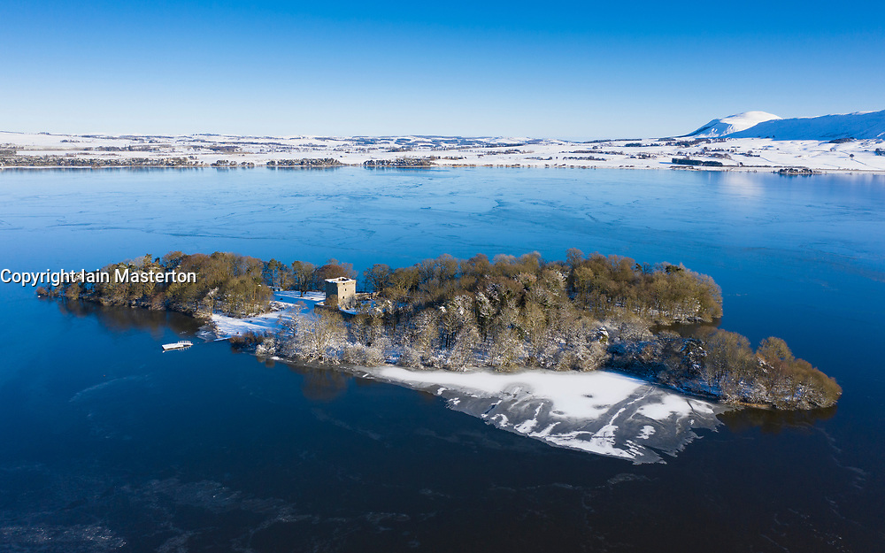 Kinross, Scotland, UK. 11 Feb 2021. Aerial view of a snow covered Loch Leven Castle situated on small loch on Loch Leven, Kinross-shire.  Iain Masterton/Alamy Live news