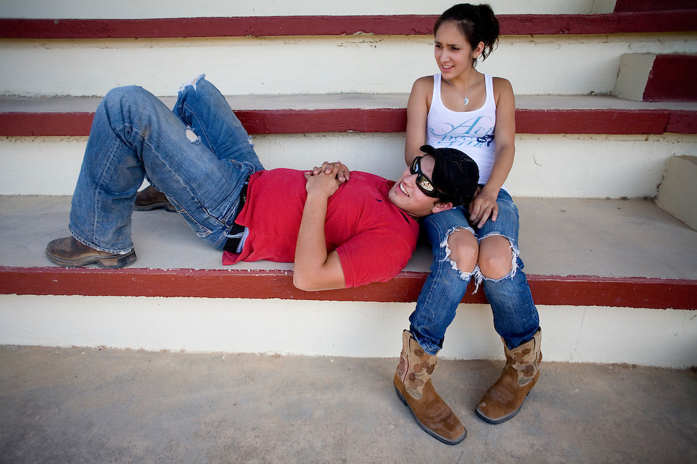 Julia Robinson photo.Ashley Martinez and boyfriend Bobby watch the charreada at the Charro Ranch in San Antonio.  Martinez performs with the Escaramuza troupe.