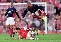 Arsenal captain Tony Adams fouls Manchester Uniteds David Beckham. Arsenal 1:0 Manchester United, F.A.Carling Premiership, 1/10/2000. Credit Colorsport / Stuart MacFarlane.