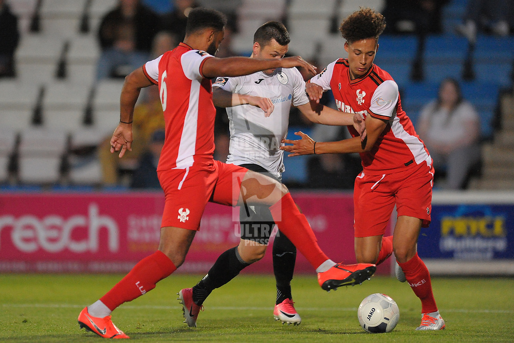 TELFORD COPYRIGHT MIKE SHERIDAN Aaron Williams battles for the ball with Rhys Williams and Ryan Johnson of Kidderminster during the National League North fixture between AFC Telford United and Kidderminster Harriers on Tuesday, August 6, 2019.<br /> <br /> Picture credit: Mike Sheridan<br /> <br /> MS201920-006