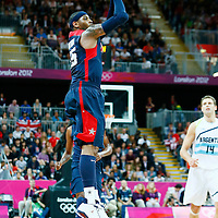06 August 2012: USA Carmelo Anthony takes a three points jumpshot during 126-97 Team USA victory over Team Argentina, during the men's basketball preliminary, at the Basketball Arena, in London, Great Britain.