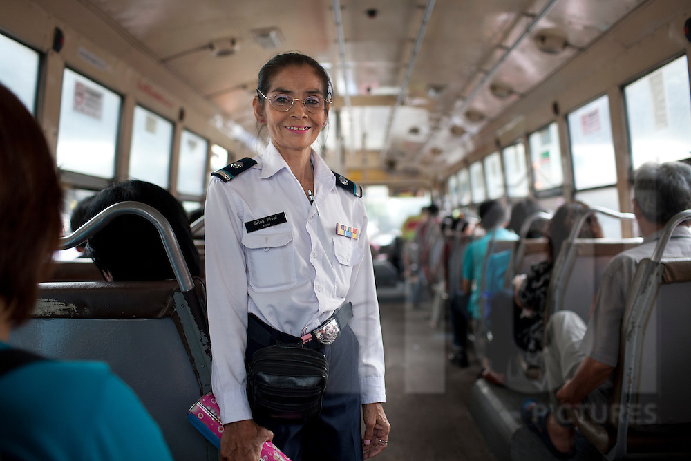 A bus driver assistant smiles at the camera, Bangkok, Thailand, Southeast Asia